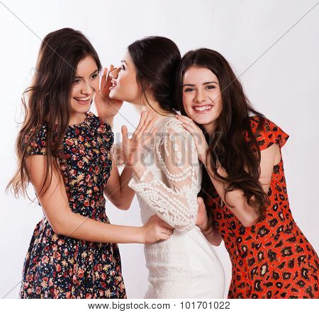 Three Smiling Women Whispering Gossip