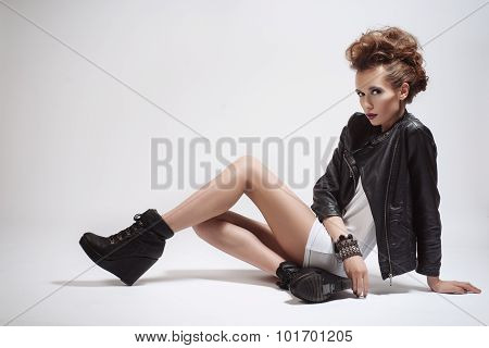Fashion Rocker Style Model Girl Portrait. Hairstyle. Rocker Or Punk Woman Makeup, Hairdo And Accesso