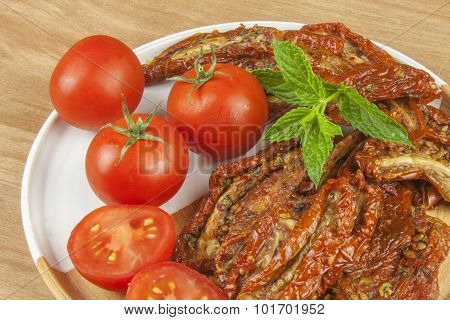 Spicy dried tomatoes marinated in olive oil. Delicious delicacy.