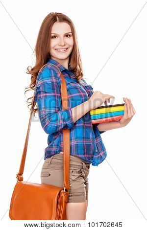 Happy young student girl holding books high school or college graduand cute casual teenager smiling