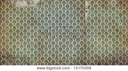 Old, damaged damask wallpaper