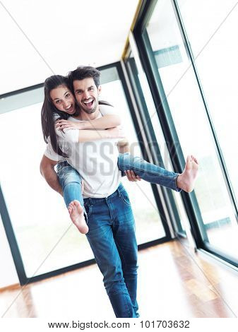 happy young romantic couple have fun relax smile at modern home livingroom indoors