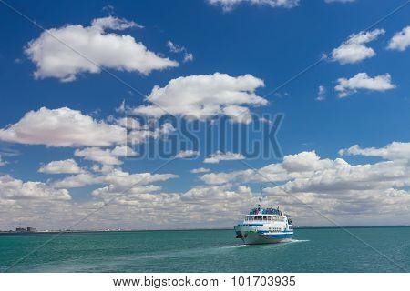 Pleasure boat is mooring to  small pier on a Black Sea