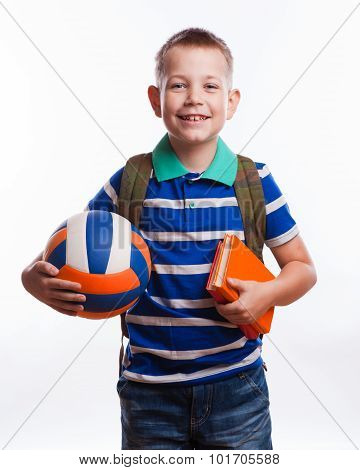 Happy schoolboy with backpack and soccer ball isolated on white background