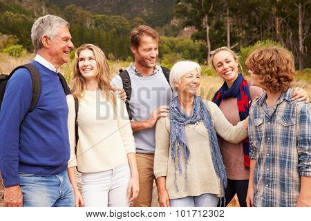 Multi-generation family bonding with each other in a forest