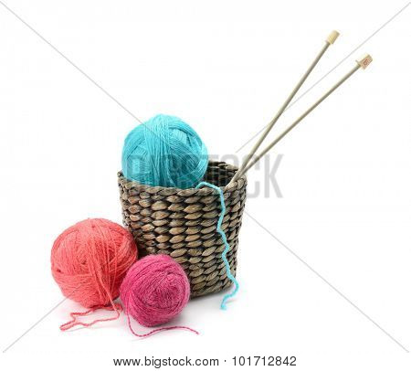 Multicolored balls and needles in basket isolated on white