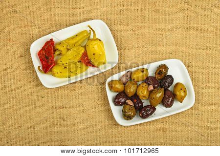 Mediterranean Snack Of Olives And Pickled Pepper On Canvas