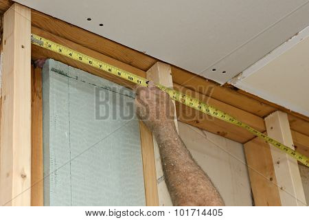 Worker Measuring Frame for Insulation