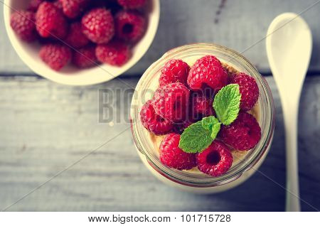 Healthy breakfast - fresh Greek yogurt with raspberries and mint