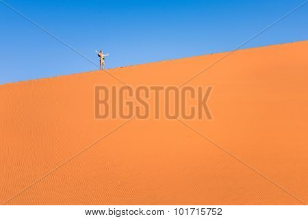 Adventurous Man Lonely Traveler Hiking On Sand Dune At Deadvlei Near Sossusvlei - Namibian Desert