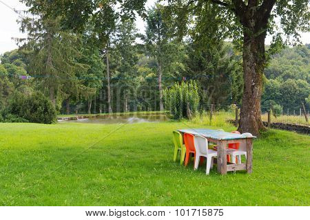 Table with chairs in garden in France