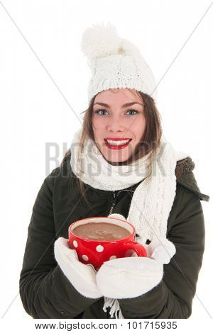 Portrait of a girl with winter coat mittens and cap and mug hot chocolate