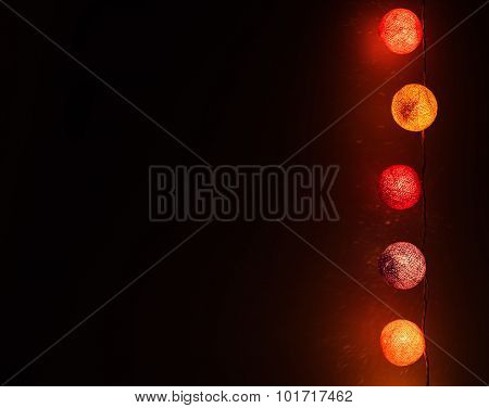 Christmas lights with fiber covers, reflections on background