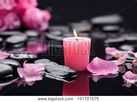 pink rose, petals with pink candle and therapy stones