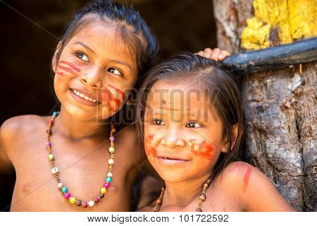 Cute Native Brazilian girls at an indigenous tribe in the Amazon