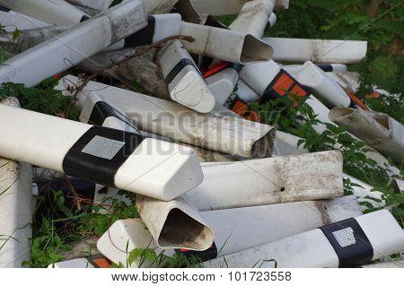 Road marking bollards old plastic
