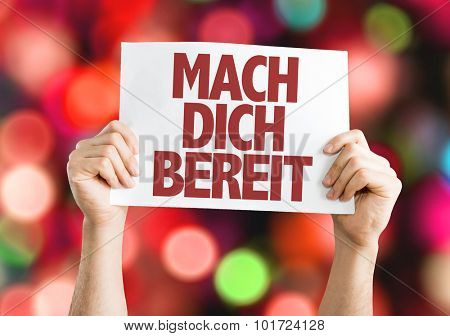 Get Ready (in German) placard with bokeh background