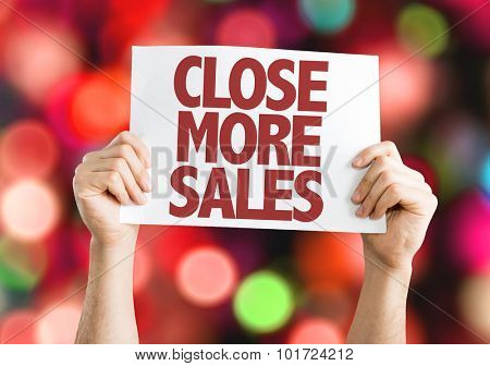 Close More Sales placard with bokeh background