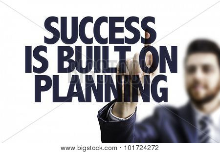 Business man pointing the text: Success is Built on Planning