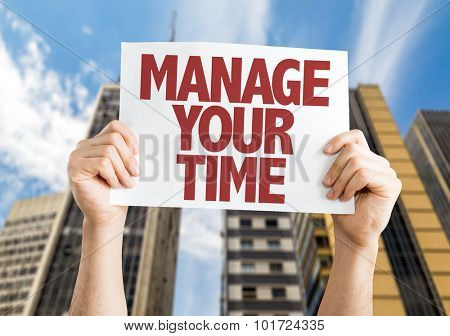 Manage Your Time placard with cityscape background