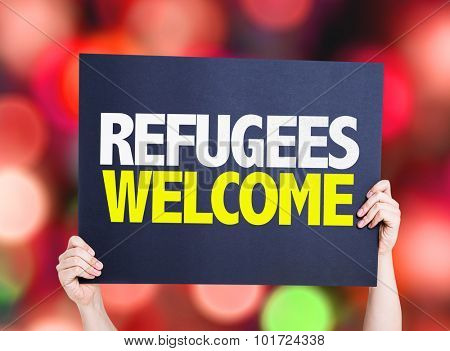 Refugees Welcome placard with bokeh background