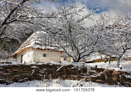 Fairy-tale Winter Authentic House With Whitewashed Walls Of Woven Fence