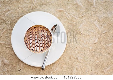A Cup Of Coffee With Latte Art