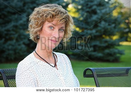 Beautifil woman sitting on a patio