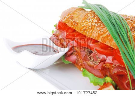 sandwich : french baguette with smoked sausage on white plate isolated over white background