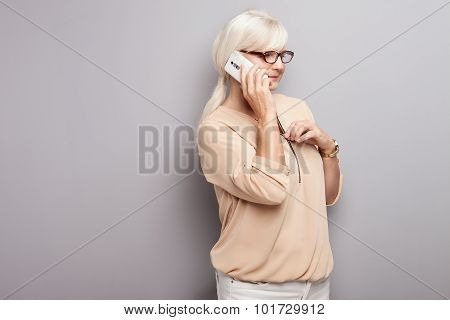 Portrait Of Attractive Senior Woman With Mobile Phone.