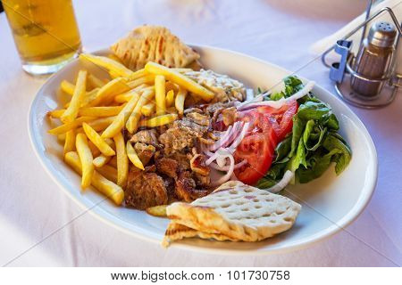 Gyros with chips on the plate