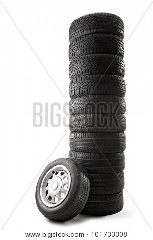 Vertical studio shot of a stack of tires piled up vertically isolated on white background