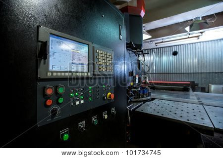 Punching machine. Foreground of control panel