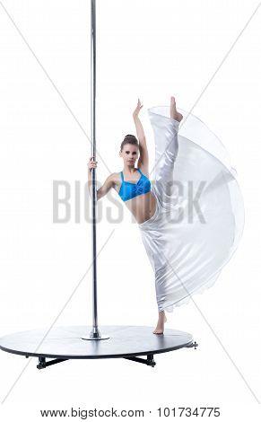Pole dance. Flexible woman posing at camera