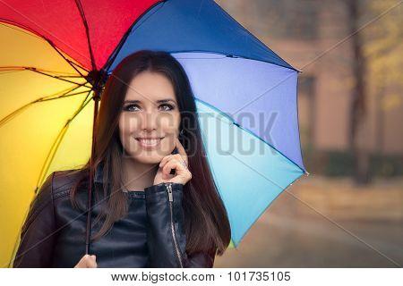 Beautiful Girl Holding a Rainbow Umbrella in Autumn Rain Decor