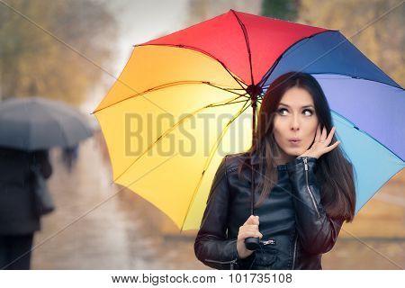 Surprised Autumn Woman Holding Rainbow Umbrella
