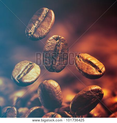 Closeup of coffee beans with focus on one.Filtered image: cool cross processed vintage effect.