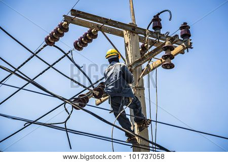 Electrician Hanging On Electricity Pole