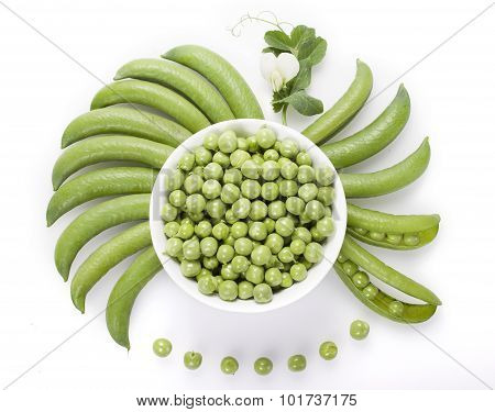 Fresh Green Peas In A White Bowl, Pea Pods Are Round Bowls  , And A Pea On A White Background.