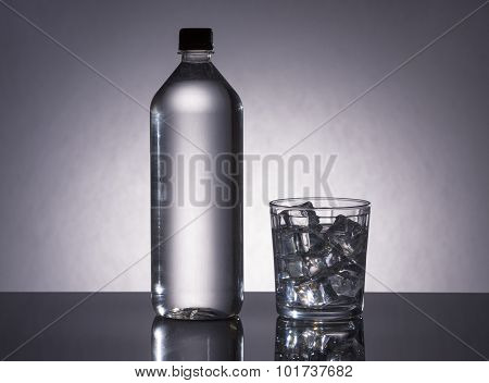 Bottle And Glass Filled With H2O.