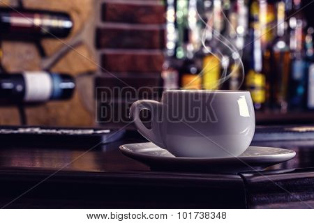 Coffee and drink. Cup of Coffee and Cognac Brandy Whiskey Aperitif Wine in modern night bar