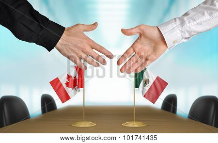 Canada and Mexico diplomats agreeing on a deal