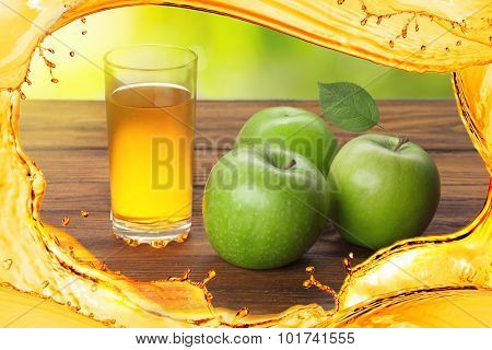 Glass of apple juice and apples with splash of juice on wooden background