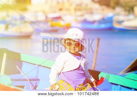 cute little girl in boat of Marsaxlokk, Malta