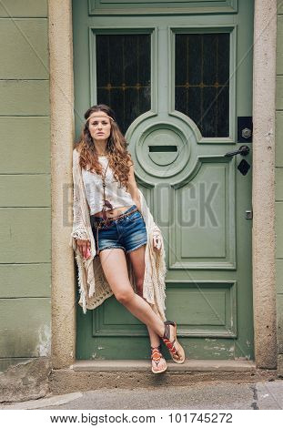 Pensive Hippie Woman In Boho Clothes Standing Outdoors