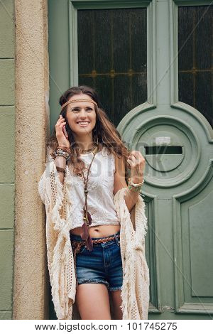 Portrait Of Happy Young Trendy Hipster Woman Talking Cell Phone