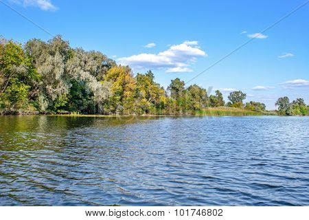 Landscape Image Of Red-haired Girl In A Canoe