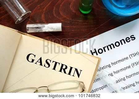 Hormone gastrin written on book.