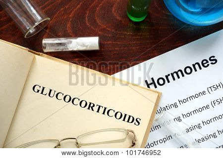 Hormone glucocorticoids written on book.