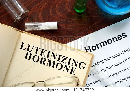 luteinizing hormone (LH) written on book.